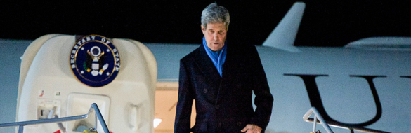 U.S. Secretary of State John Kerry steps off his airplane after arriving in Vienna, Austria, on November 20, 2014, to join negotiations with Iranian officials about the future of their nuclear program.