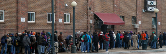 A shelter in Denver has a long line as it starts to rain.
