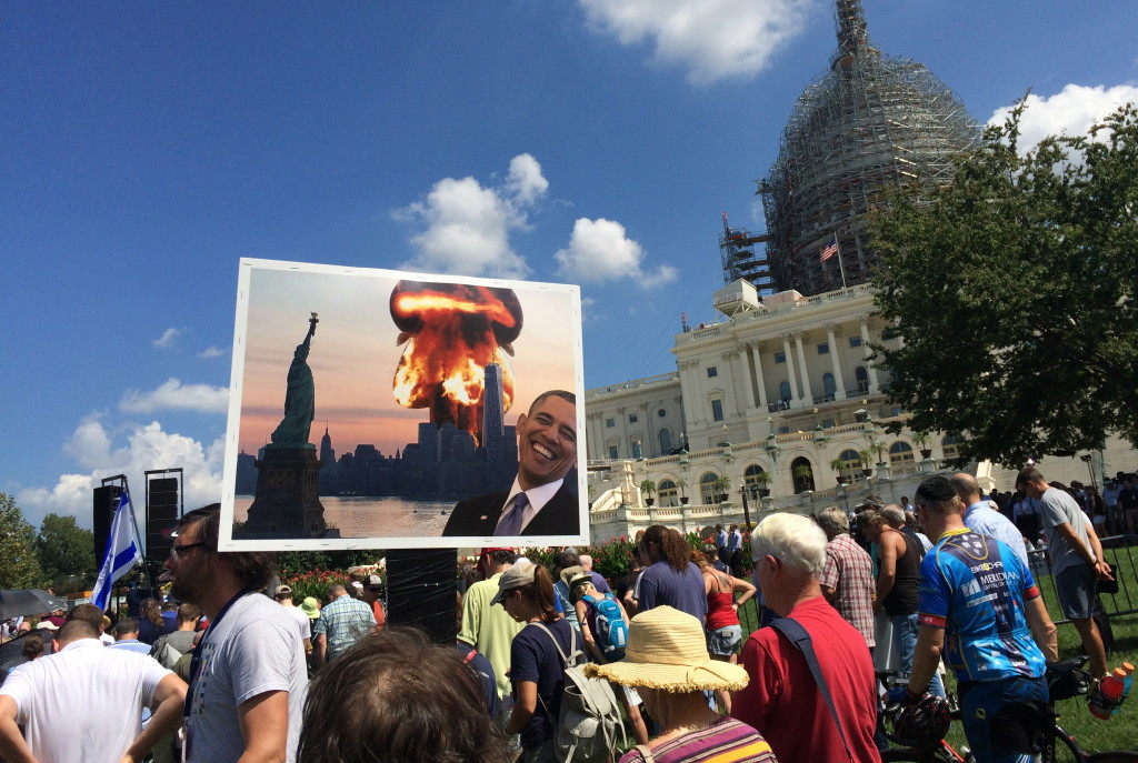 A sign held by New Jersey resident Rebecca Bergknoff envisions apocalyptic consequences of President Barack Obama's nuclear deal with Iran.