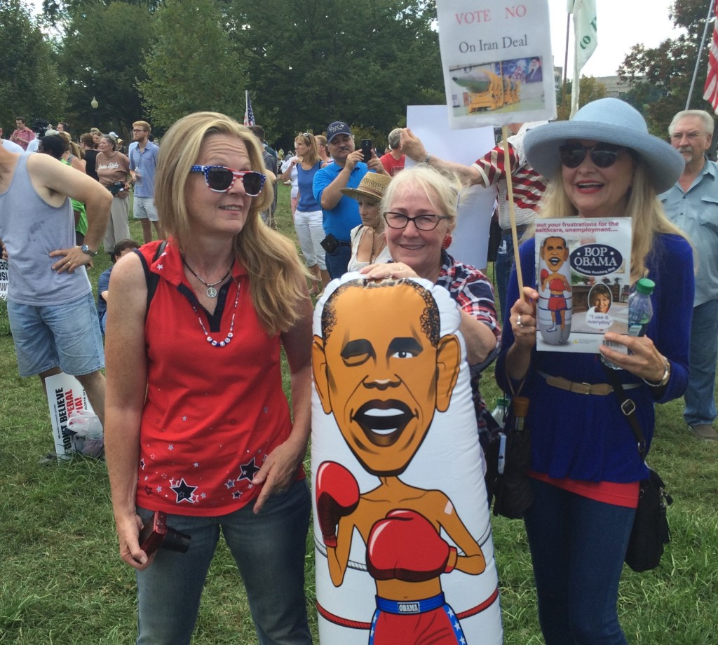 Arizona residents Debbie Schroeder, Rose Prescott, and Diane Delaura brought an Obama punching bag to Wednesday's rally against the president's Iran deal.