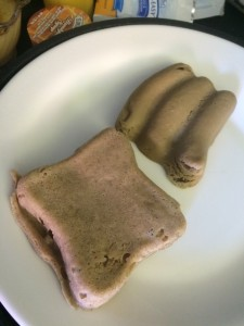 Pureed french toast and sausage reformed with molds to be served to a patient unable to swallow solid foods.