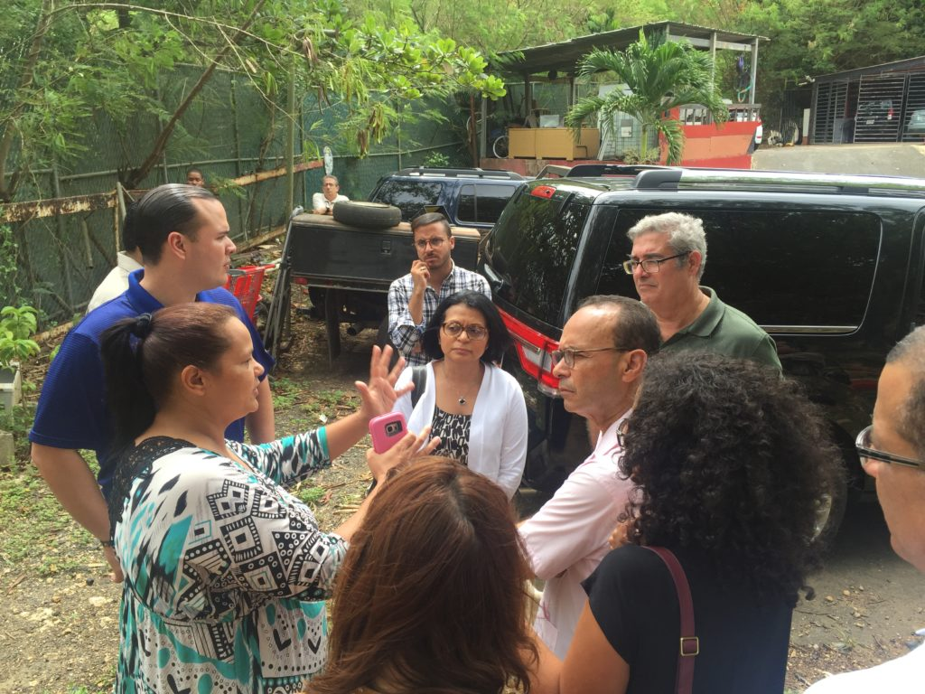 Yahaida Porratas (left), 40, of Toa Baja, is telling Rep. Luis Gutierrez (D-Ill.) about her living conditions next to the landfill. (Photo Credit: Kyle Plantz/InsideSources)
