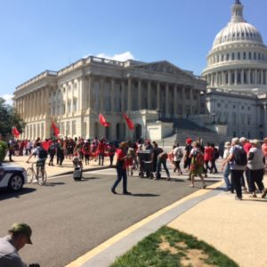 Environmental Protest Forms a Red Line On the Capitol East Lawn