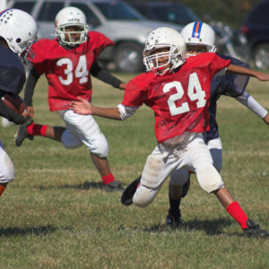 Are Youth Football Groups Doing Enough to Protect Kids From Injury?