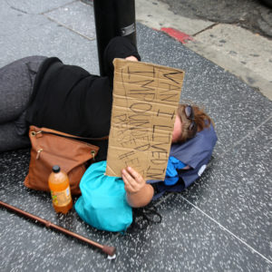 The Energy Executive and the Homeless — Sleeping on Concrete