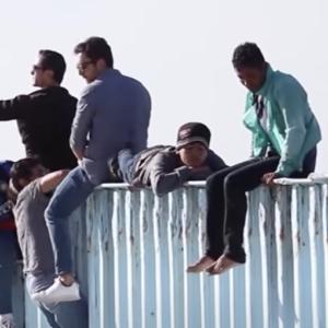 'Biden, Let Us In!' Frustrated Migrants Crowd Border Believing Amnesty Awaits